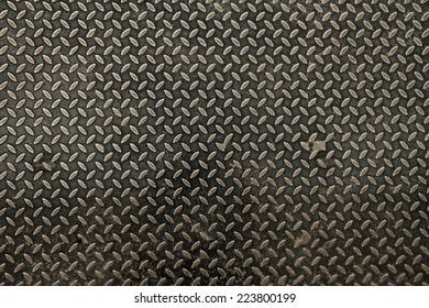 Metal texture diamond plate, industrial background, Aluminium dark list with rhombus shapes.