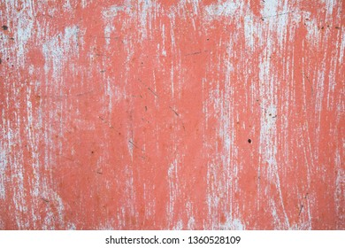 Metal texture with scratches and cracks. Metal background with pink and white paint.