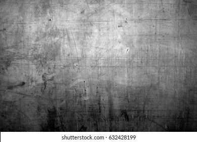 Metal texture with scratches and cracks. Image includes a effect the black and white tones.