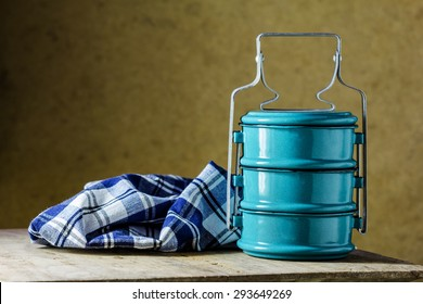 metal Tiffin carrier, thai food carrier on brown background