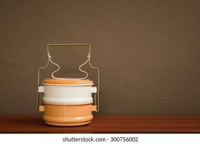 Metal Tiffin carrier, Thai food carrier on wall background vintage style color tone.