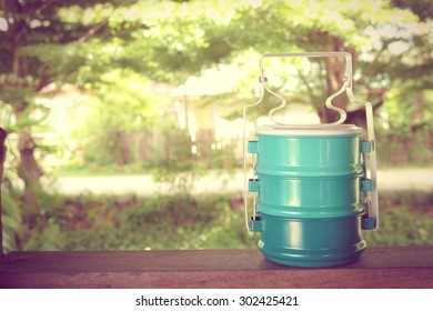 Metal Tiffin Food Carrier Thai Style, Thai Lunch Box, with Abstract Blur Countryside Background  [Vintage Collection]
