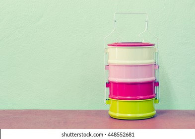 metal Tiffin, thai food carrier on mint background in pastel color
