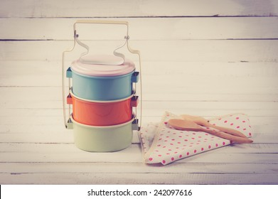 metal Tiffin,thai food carrier on wooden table background.vintage color toned image