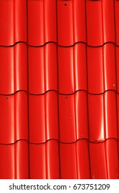 Metal tiles. Advertising of a natural set of colored painted metal sheet for roofs. Modern roofing materials for housing. Modern technologies in construction. Reliable modern roofing materials