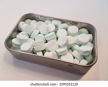 metal tin of breath mints