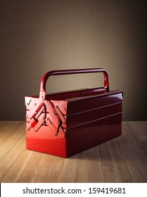 Metal toolbox on wooden table