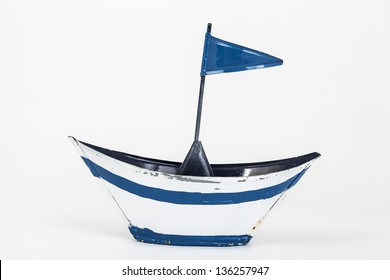 metal toy boat with flag on white background