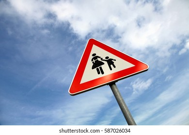 Metal traffic triangle road sign with pedestrian mark background.