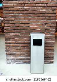 Metal trash box front the brick wall. Maslak 42 building. Maslak. İstanbul. July 2018.