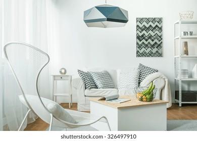 Metal trendy furniture in simple living room