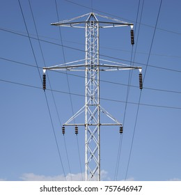 Metal Utility Tower with Lines against a Blue Sky