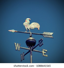 metal vane with a rooster with cardinal points indicating the wind direction