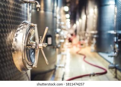 Metal vats for fermentation. Wine factory. Steel barrels in winery.