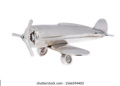 Metal vintage aircraft toy, with front propeller. Isolated on white
