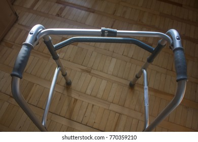 Metal walker on the background of parquet