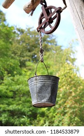 Metal Water Bucket Hanging on Pulley
