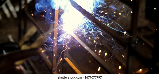 Metal welding. Sparks from electric heating. Creation, work.