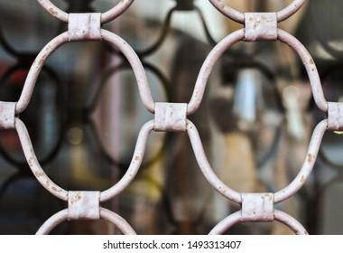 Metal white lattice on the window pattern. Blurred background