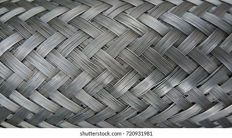 Metal wire braiding. Steel texture. Background.