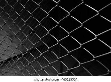 Metal wire fence or cage with blur background. Abstract background