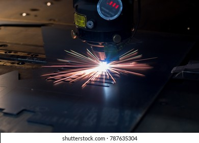 metal working. Laser cutting technology of flat sheet metal steel material processing with sparks.  Maybe little blurred.