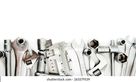 Metal working tools. Metalwork. Spanner , ruler, caliper and others tools on white background.