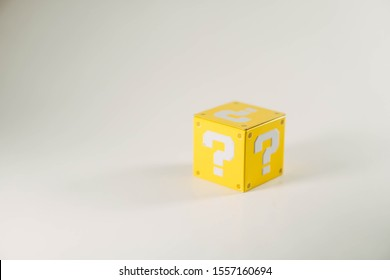 Metal Yellow Cube with a Question mark