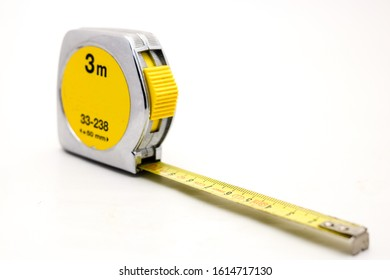 Metal yellow tape measure isolated on white background flexible ruler used to measure distance