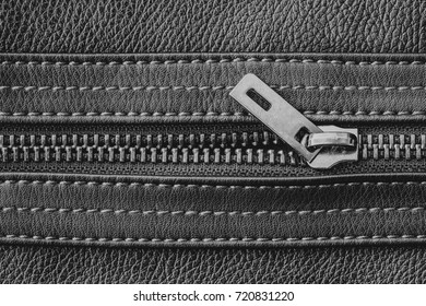 Metal zipper in leather jacket texture.