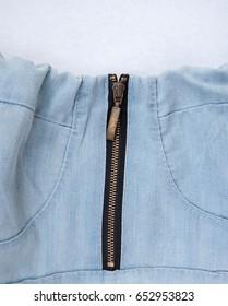 Metal zipper on denim dress