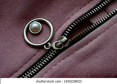 metal zipper on pink leather skirt, close up hoto