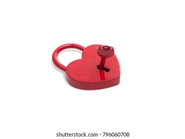 metalic red heart with a key on the white