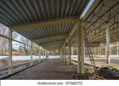 Metall Construction. Construction of the hangar. - Shutterstock ID 377682772