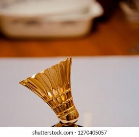 A metallic artificial badminton cork isolated object photo