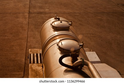 A metallic aviation fuel container isolated object unique photograph