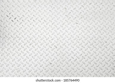 Metallic background with texture detail of a slip metal floor background with highlight