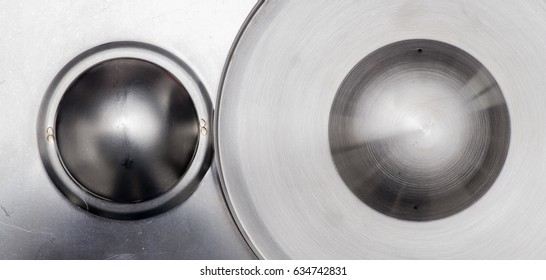 Metallic background, two domes side by side, silver.