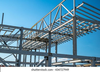 Metallic building construction under blue sky.