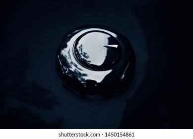 Metallic caps of a bike's petrol tank isolated object photo