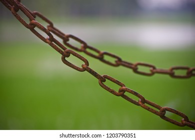 Metallic chains with green background unique photo