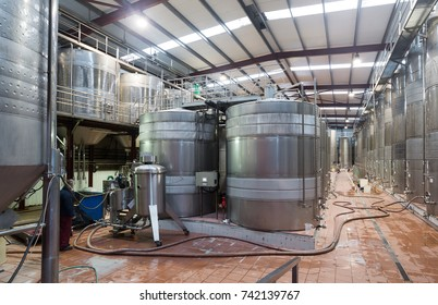 Metallic cisterns for processing and fermentating wine in fabric shop