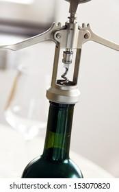 metallic cork screw in wine bottle