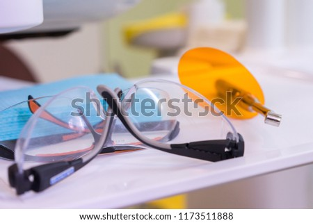 Metallic dentistry tools for the dentist, modeling, carving tools, safety goggles