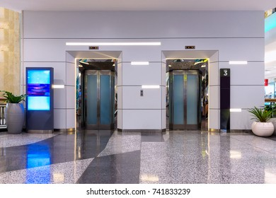Metallic Doorway of Modern Elevator in Office Building, Architecture Contemporary of Door Lift and Interior Lighting Decorative. Electronic Control Panel and Flooring Symbol Signage of Elevator