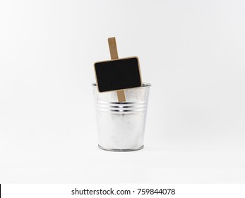 Metallic flower pot with wood signboard isolated on white background