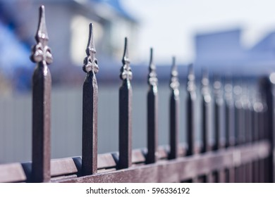 Metallic Forged Fence In The Garden With Spikes.