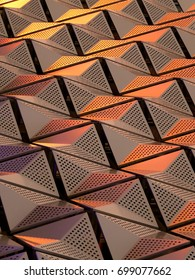 metallic geometric cladding or panels in copper and gold colors with repeating angular pattern