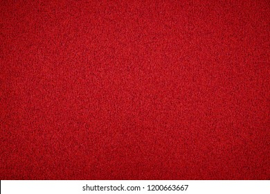 Metallic glitter red background, close up. Red paper backround. Red glitter background from wrapping paper.