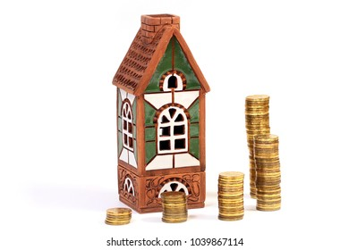 metallic gold color Russian rubles and clay house as a symbol of lease